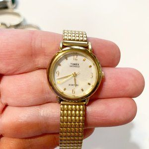 Timex Indiglo gold tone stretch band watch